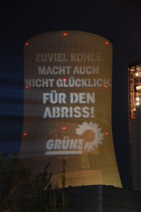 anti-coal-slogan onto the colling tower of a fired power station